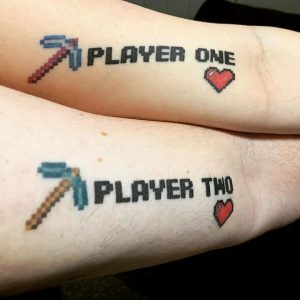 Player One and Player Two tattoos